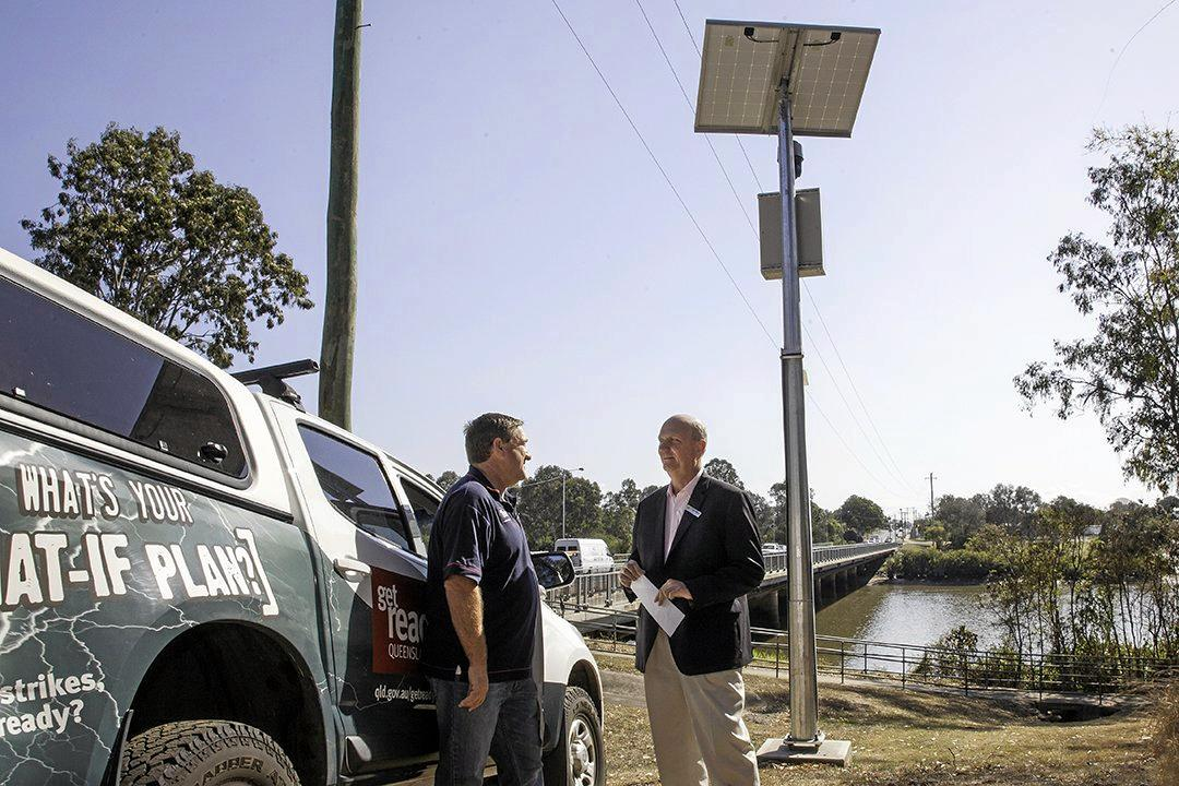FLOOD PREPARED: Local Disaster Management Group Chair Councillor Rolf Light (right) talks with Disaster Planning Coordinator Brendan Guy about the new Lamington Bridge flood camera.