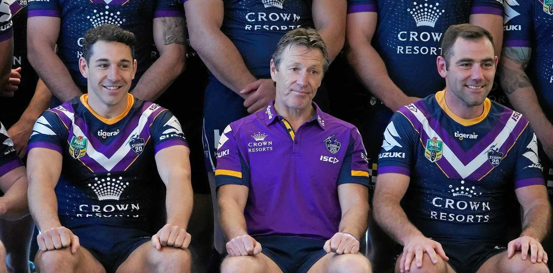 Storm coach Craig Bellamy with two of the men he is relying on to deliver the club back-to-back premierships, star fullback Billy Slater, left, and captain Cameron Smith, right. Picturre: Stefan Postles/AAP