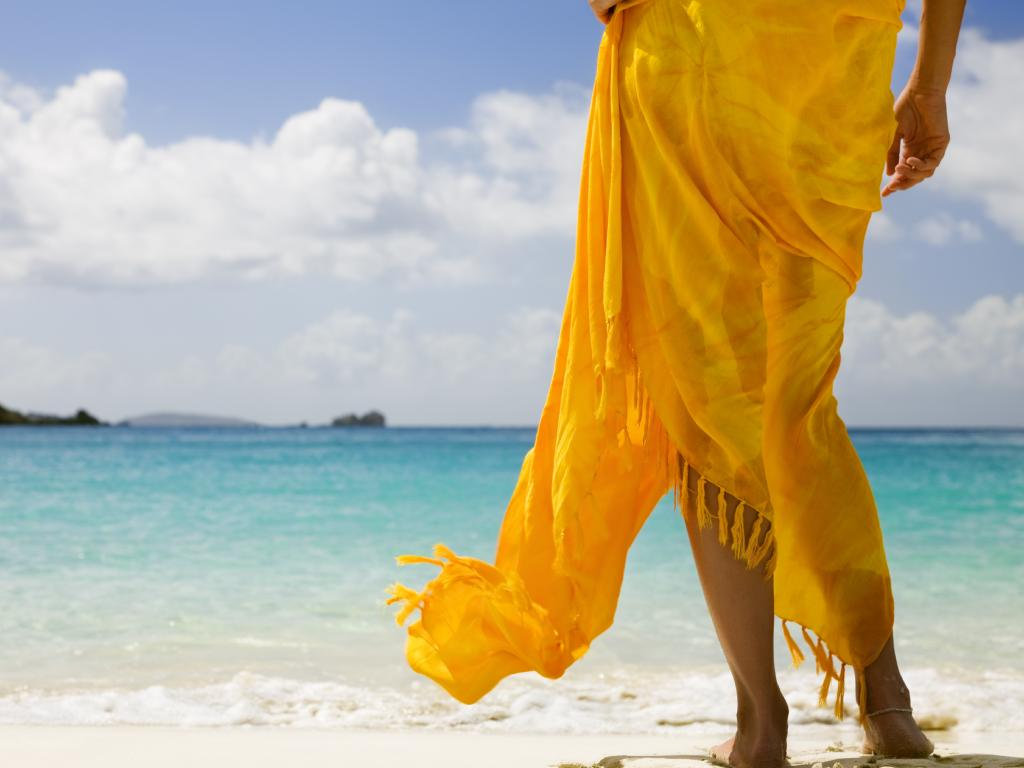 A sarong can be used to separate your luggage — and to wear on the beach.