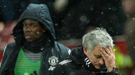 The row between Paul Pogba (L) and Jose Mourinho continues