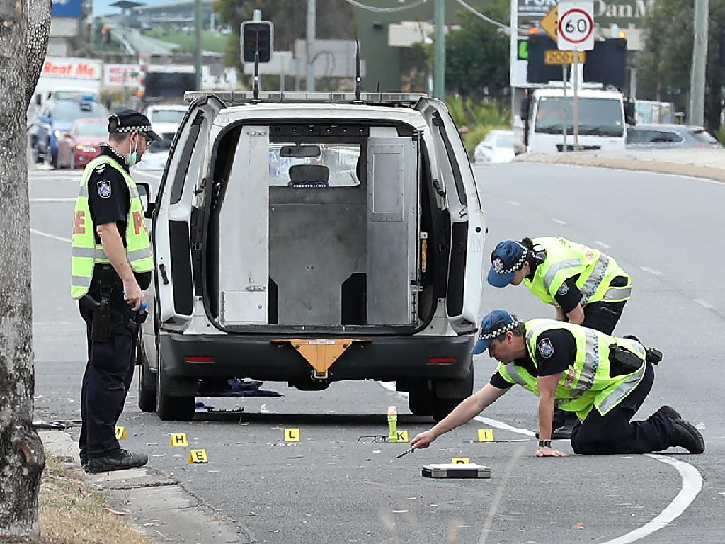 Police investigating the scene of a hit and run of a police officer, who was attempting to stop a stolen car, Brisbane Road, Booval. Photographer: Liam Kidston.