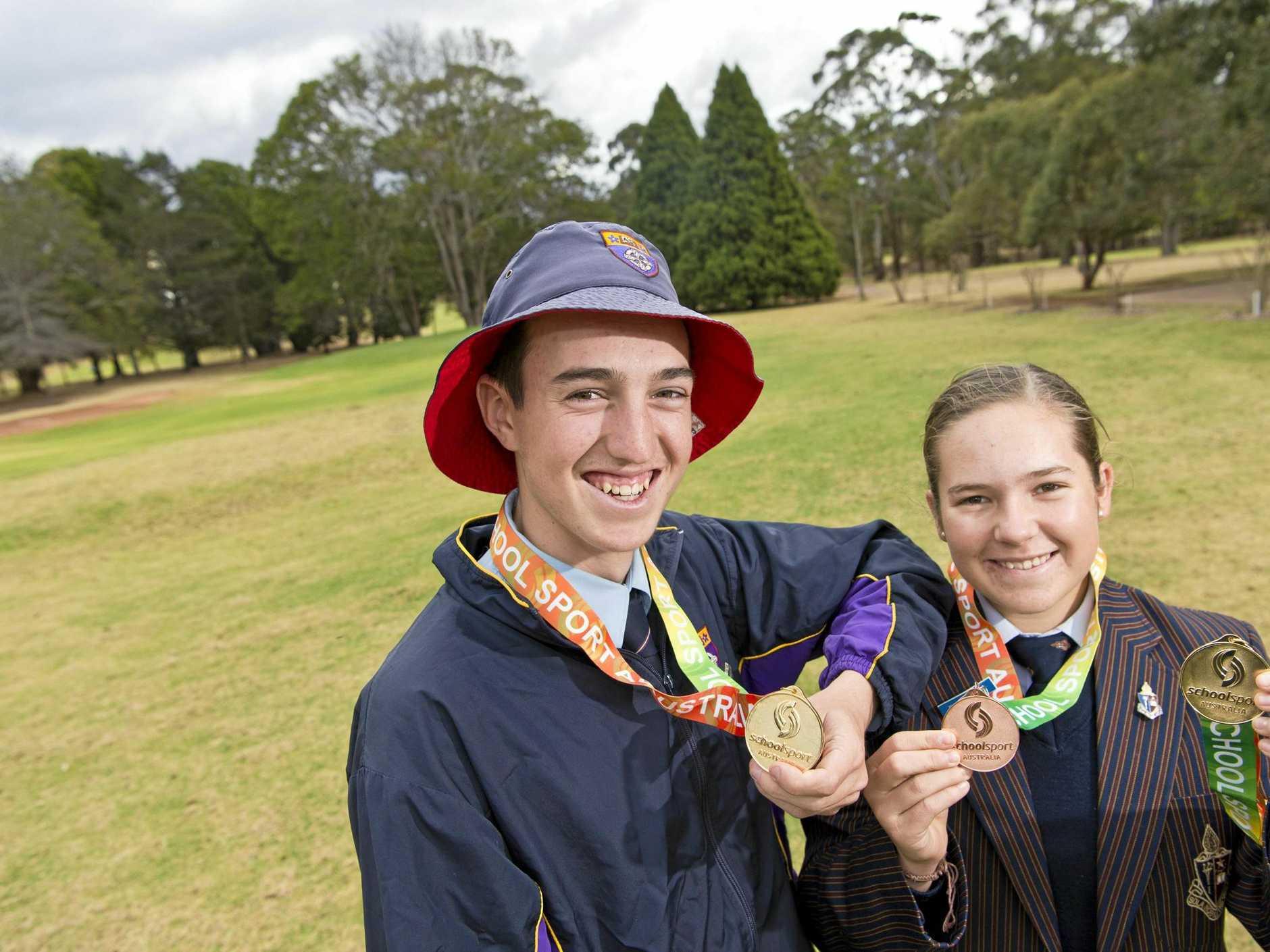 Toowoomba junior golfers Quinn Croker and Kamryn Dunemann show their medals from the 2018 School Sport Australia under-17 golf championships, Thursday, September 6, 2018.