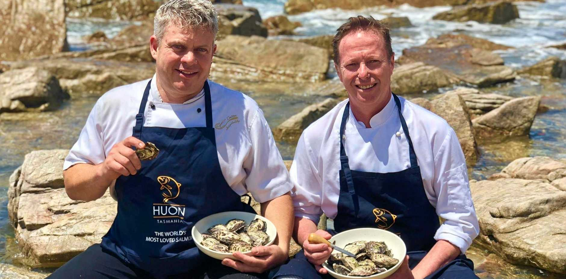 Seabreeze Hotel chef Jerome Dalton and seafood specialist Murray Dalton sample fresh angasi oysters that will be for sale at the Lamberts Beach Oyster Festival Sunday.