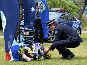 Coast stops to honour fallen police