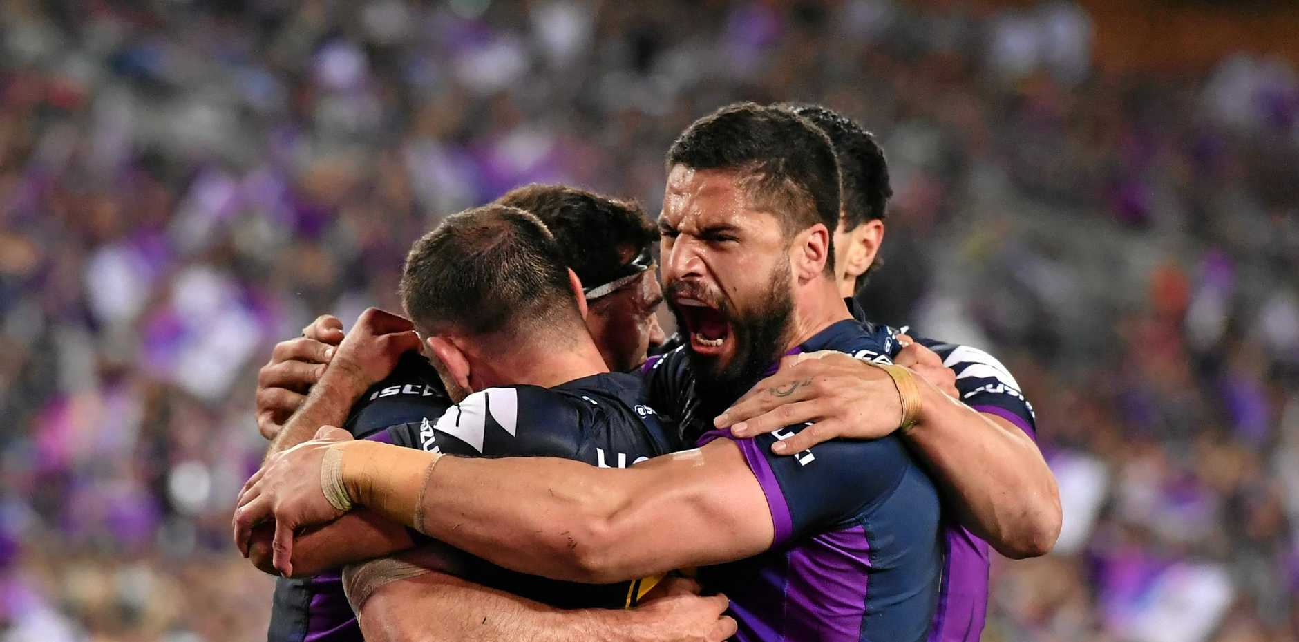 Storm players celebrate after scoring a try during the NRL grand final 2017. Police are bracing themselves for a spike in family violence this grand final weekend.