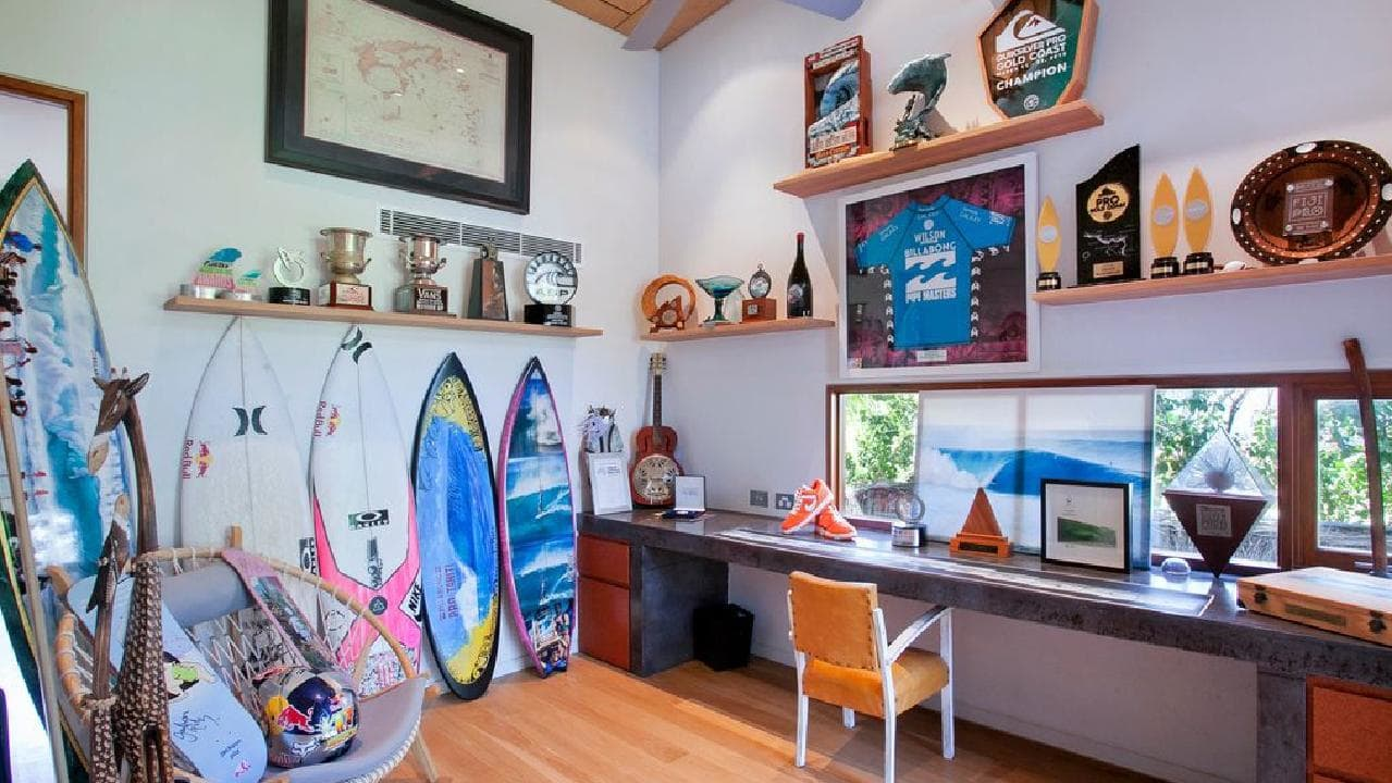 "Julian Wilson's ""office"" with surfboards and trophies."