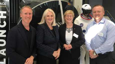 Adam Gilmour, Minister for Industry, Science and Technology Karen Andrews, head of the new Australian Space Agency Dr Meghan Clark and James Gilmour with Gilmour's Mercury capsule replica at the 18th Australian Space Research Conference at the Mantra on View Hotel in Surfers Paradise.