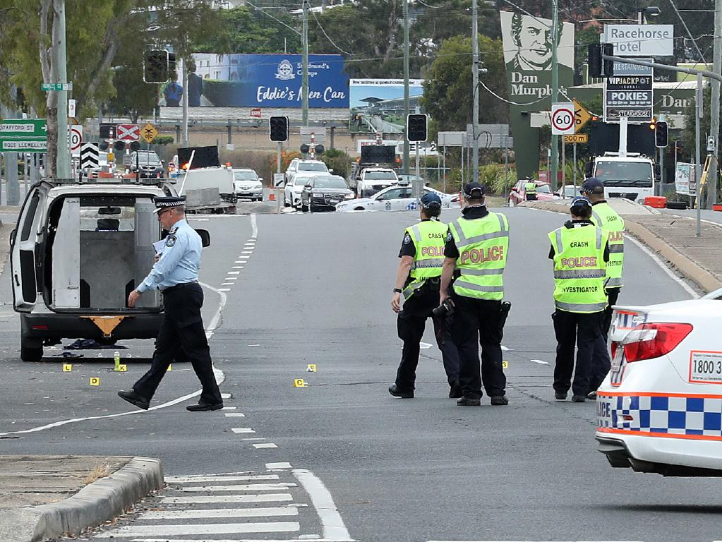 Police inspect the scene on Brisbane Road, Booval. Photographer: Liam Kidston.