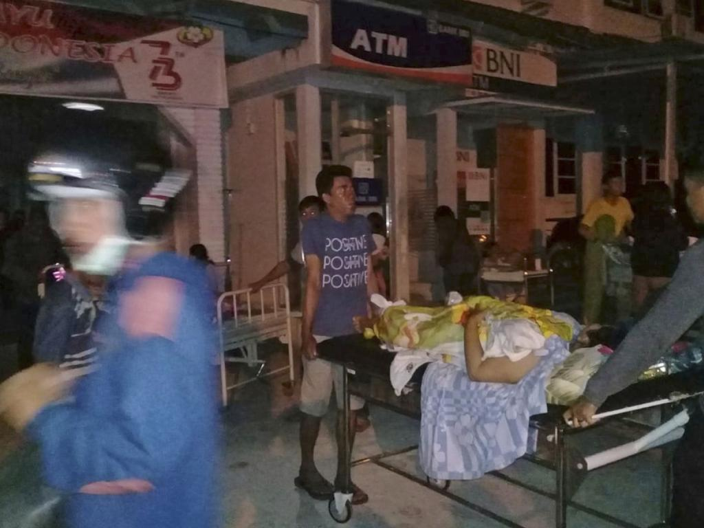 A patient is evacuated from a hospital following a strong earthquake in Poso, central Sulawesi, Indonesia.  Picture:  AP