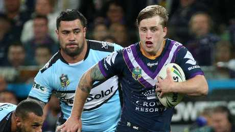 Cameron Munster makes a break for the Storm. Picture: AAP