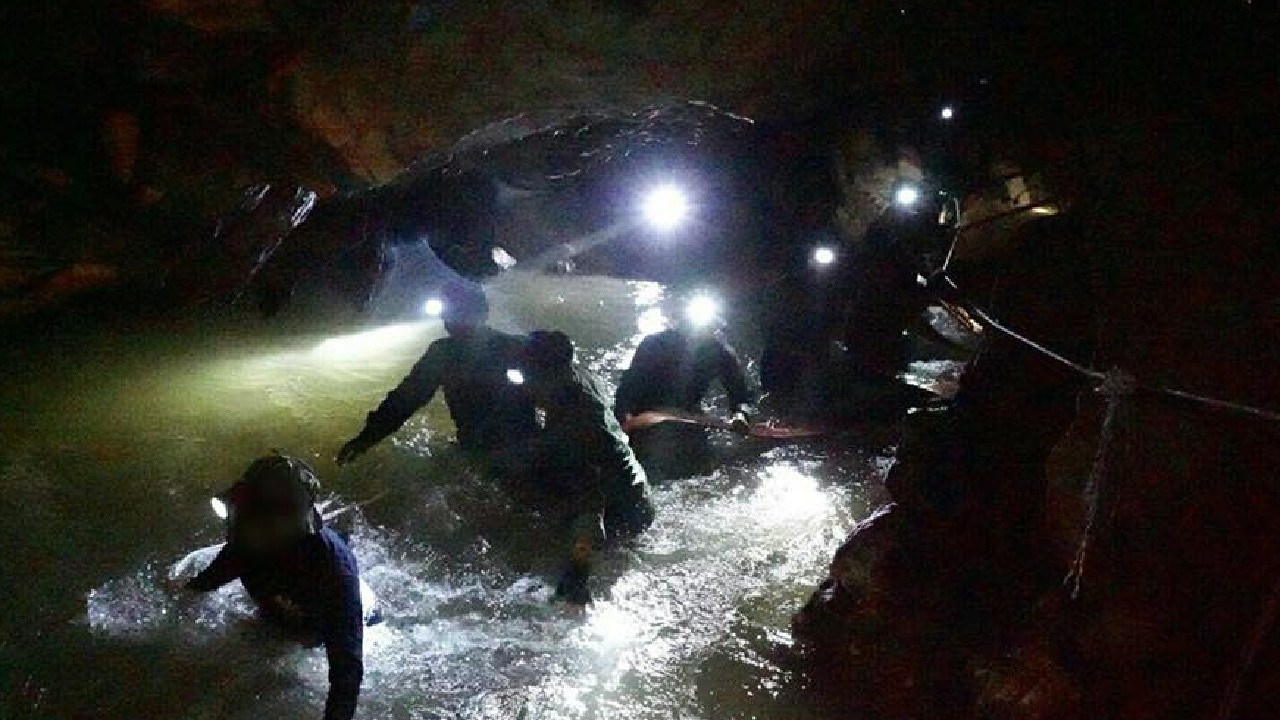 British divers had unexpectedly found four workers from the Thai Well Water Association trapped in the cave from having tried to locate the soccer team themselves. Picture: Thai Navy SEAL via Getty Images