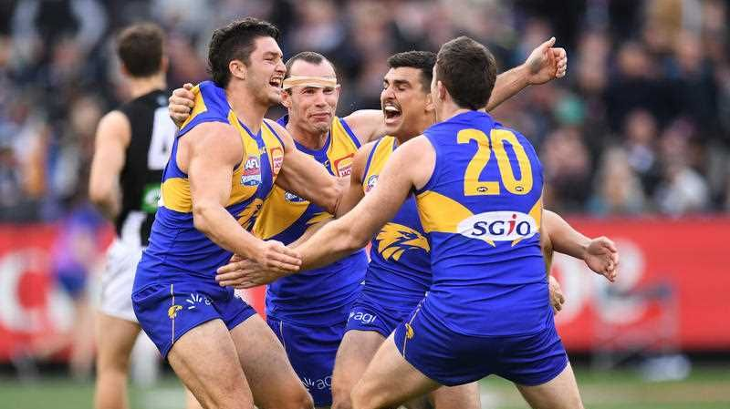 Eagles players react after winning the 2018 AFL Grand Final between the West Coast Eagles and the Collingwood Magpies at the MCG in Melbourne, Saturday, September 29, 2018.