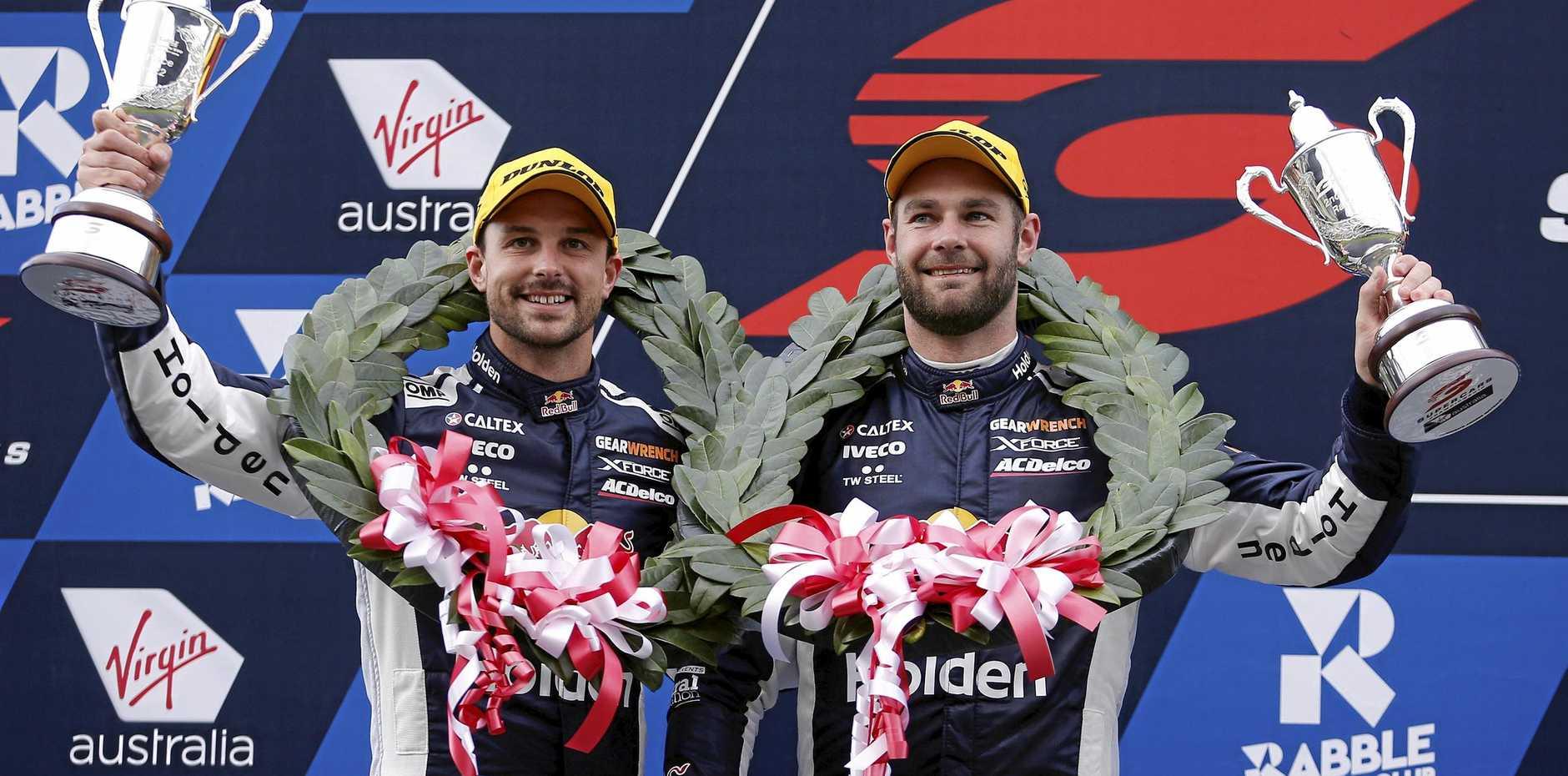 Red Bull Holden Racing Team's Earl Bamber and Shane van Gisbergen on the podium after finishing second in the Sandown 500 on September 16. Picture: Daniel Pockett/AAP