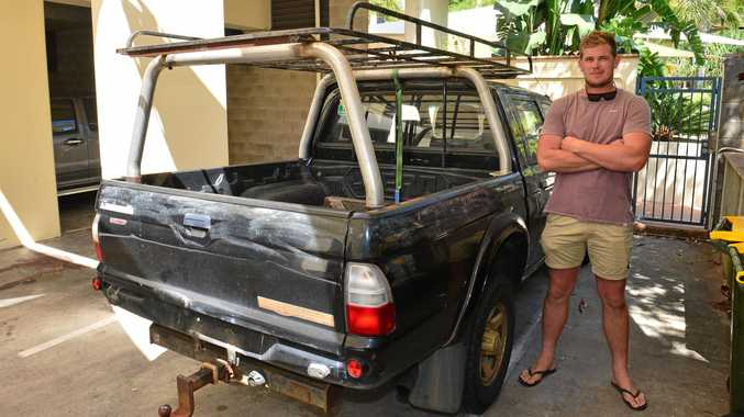 Builder Nick Phelan inspects his ute after it was stolen from his home.