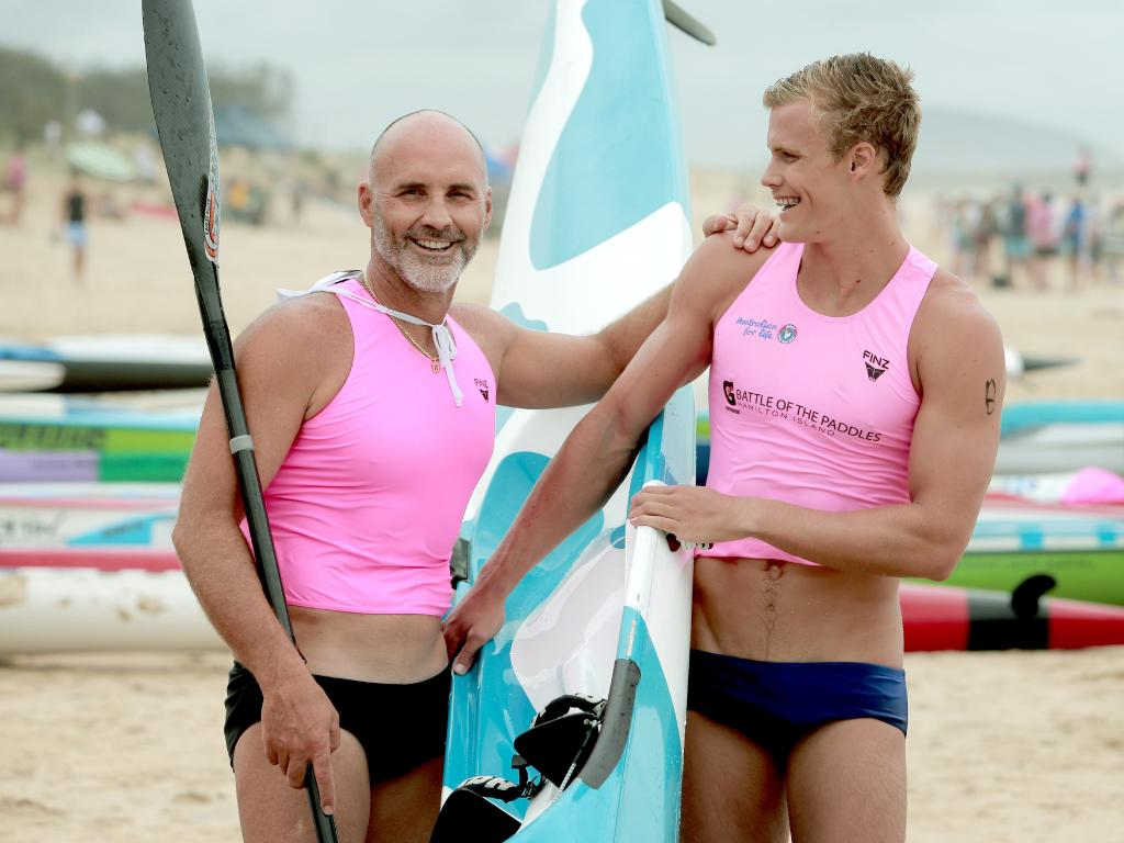 Grant and Jett Kenny in 2013 while paddling in the Open Mens Ski relay final at the Murphy Builders Maroochy Surf Classic Surf Carnival, Maroochydore Beach. Picture: Mark Cranitch.