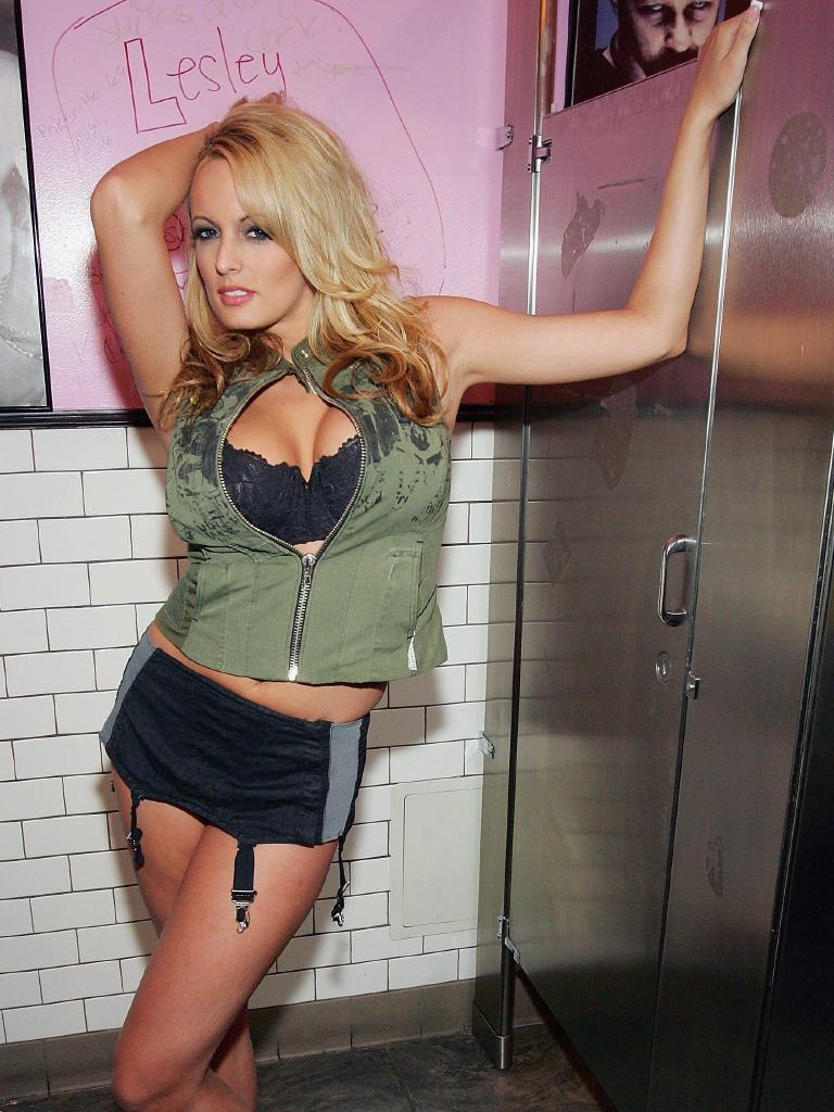 Adult film actress Stormy Daniels poses in a creation by Junker Designs after a fashion show debuting the company's new collection at the Rainbow Bar & Grill as part of the MAGIC convention August 28, 2006 in Las Vegas, Nevada. Picture: Ethan Miller/Getty Images.