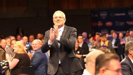 Scott Morrison arrives at the North Melbourne AFL breakfast. Picture: AAP Image/David Crosling