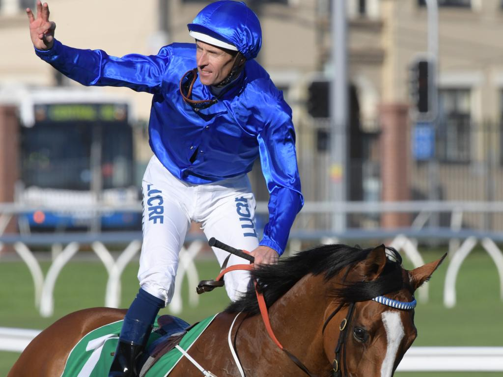 Hugh Bowman celebrates his first Group 1 for the Godolphin camp.