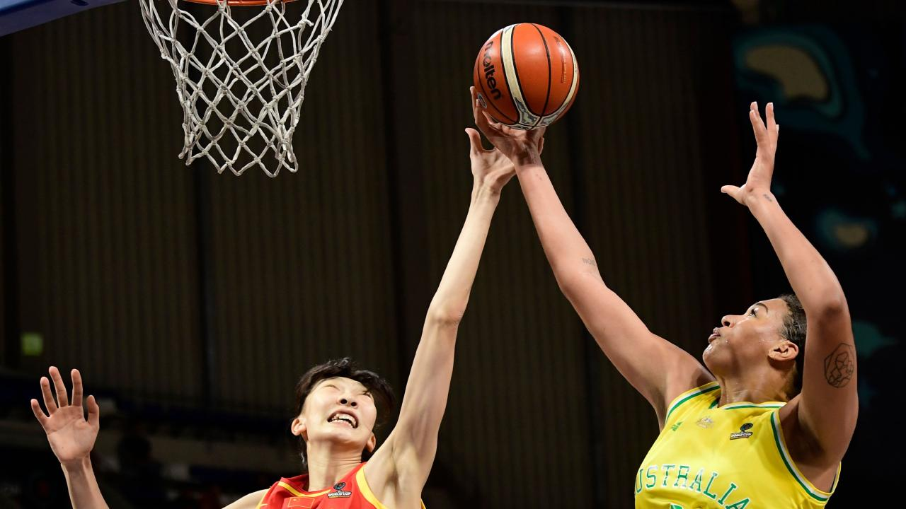 Australia's center Liz Cambage, right, rises high against China.