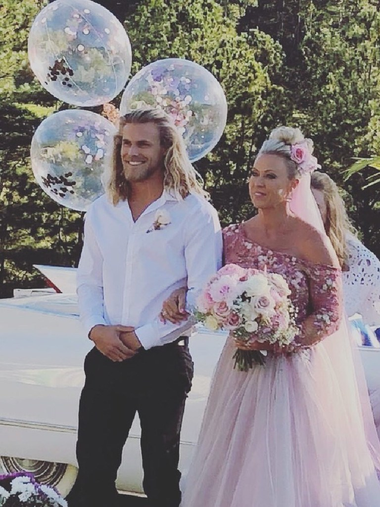 Jett Kenny walks his mum Lisa Curry down the isle at her wedding. Picture: Supplied