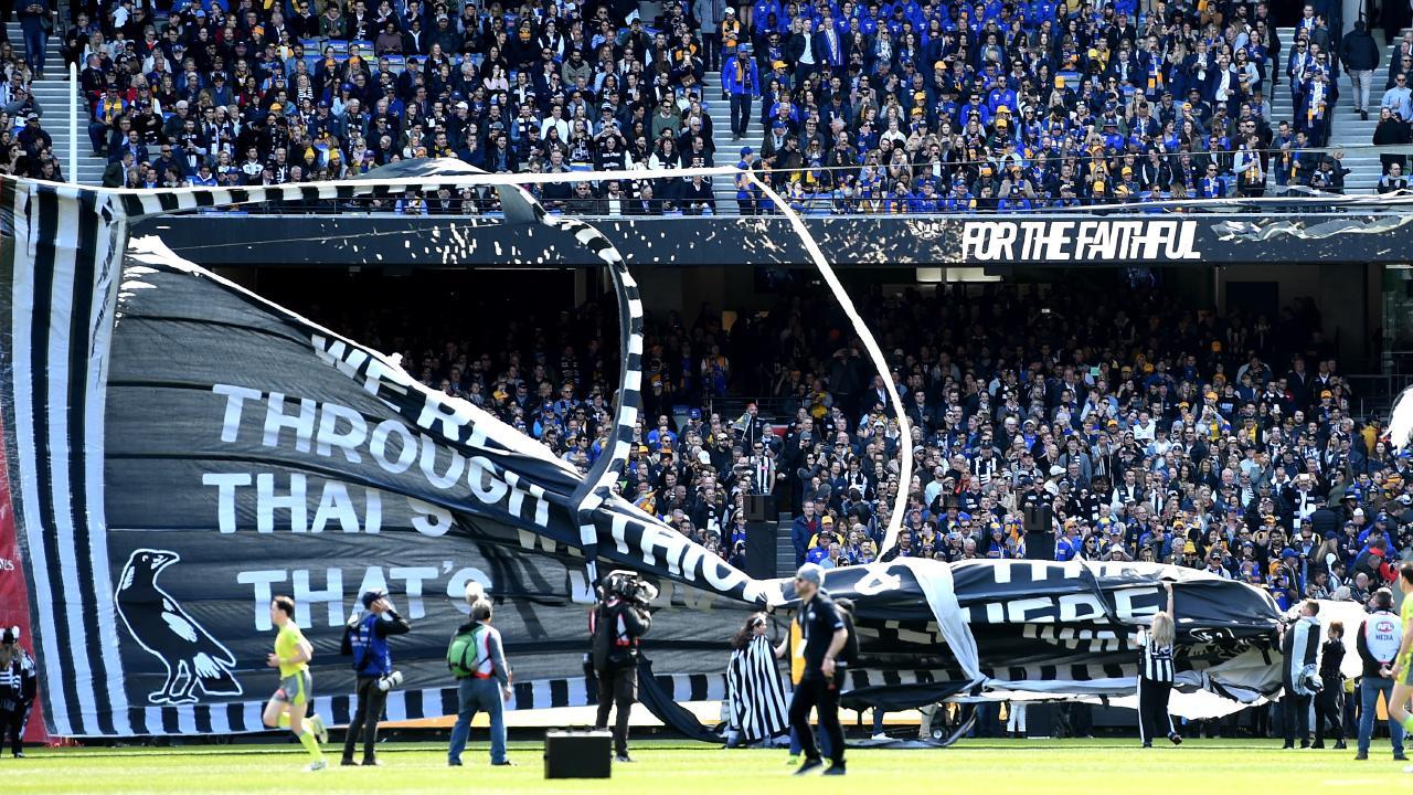 The Collingwood banner falls apart Picture: Nicole Garmston