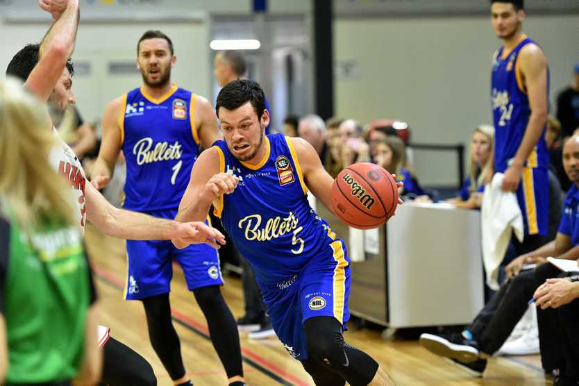 Jason Cadee drives to the basket during a pre-season hit-out.
