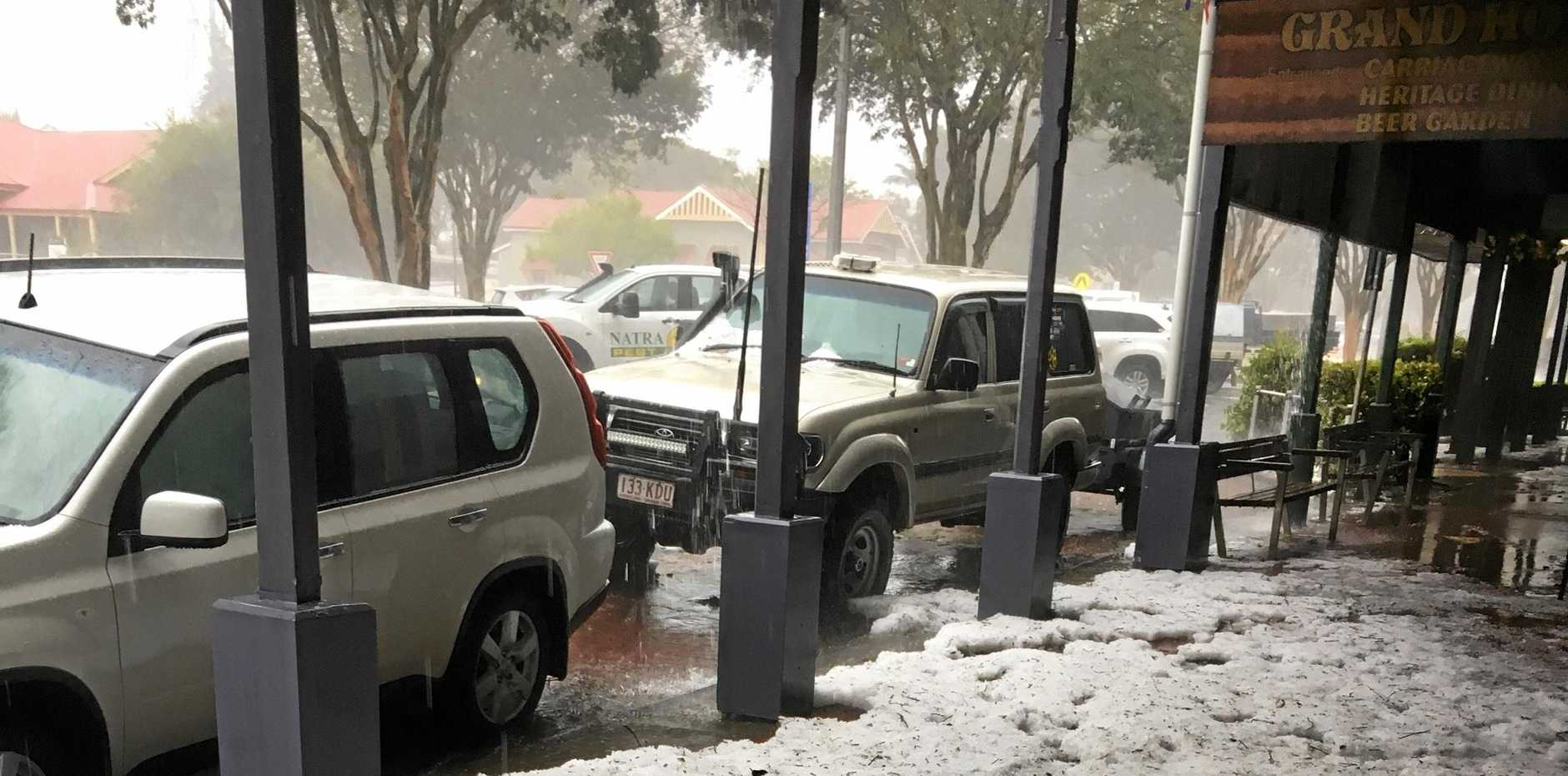 SNOW: Grand Hotel manager Sean Docherty said the cyclone-like storm had left a snow-like layer of hail at the front of the Childers pub.