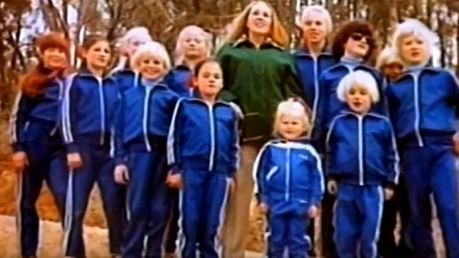 Children from the cult 'The Family', dressed in identical tracksuits, some with bleached hair.