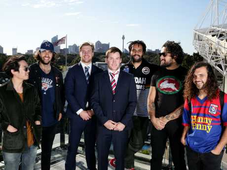 Gang of Youths stand with the Roosters' Luke Keary and Storm's Cameron Munster ahead of NRL grand final.