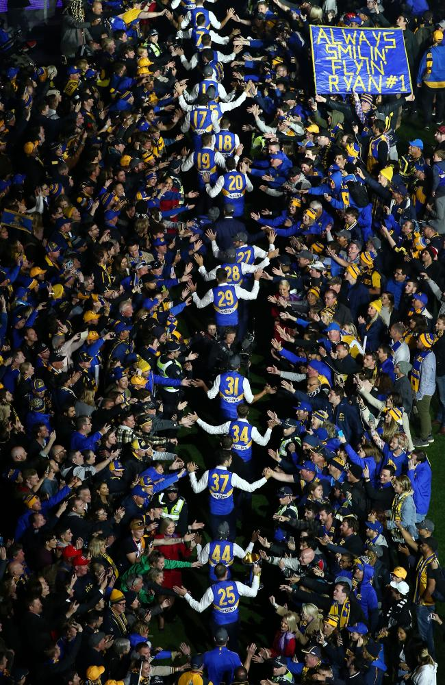 The Eagles walk through the crowd at the MCG. (Photo by Scott Barbour/AFL Media/Getty Images)