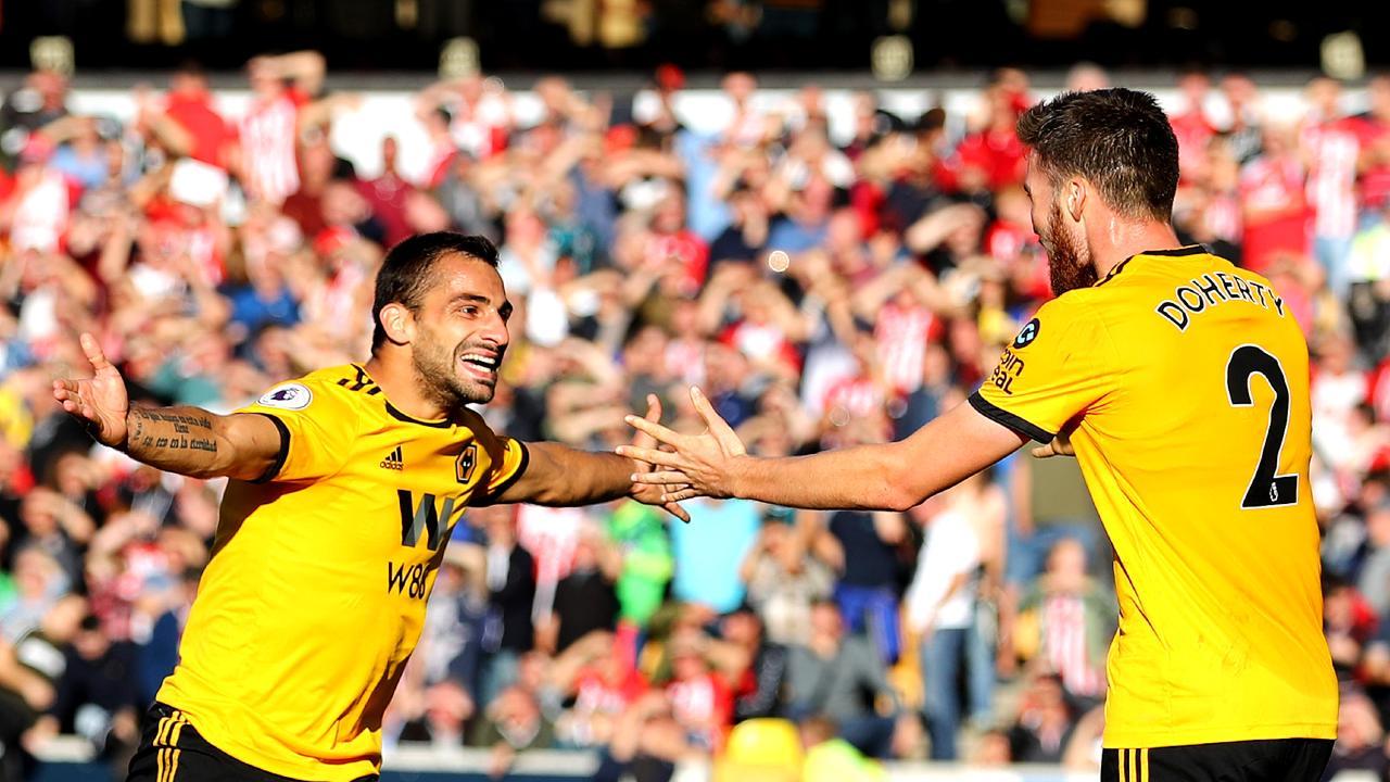Jonny Otto celebrates scoring his sides second goal with Matt Doherty.