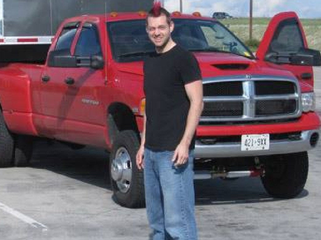 Dellen Millard poses with Tim Bosma's stolen ute, which Millard had repainted red in the days after Mr Bosma's murder. Picture: Supplied