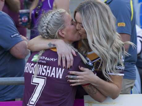 Ali Brigginshaw of the Broncos celebrates with partner Kate Daly.