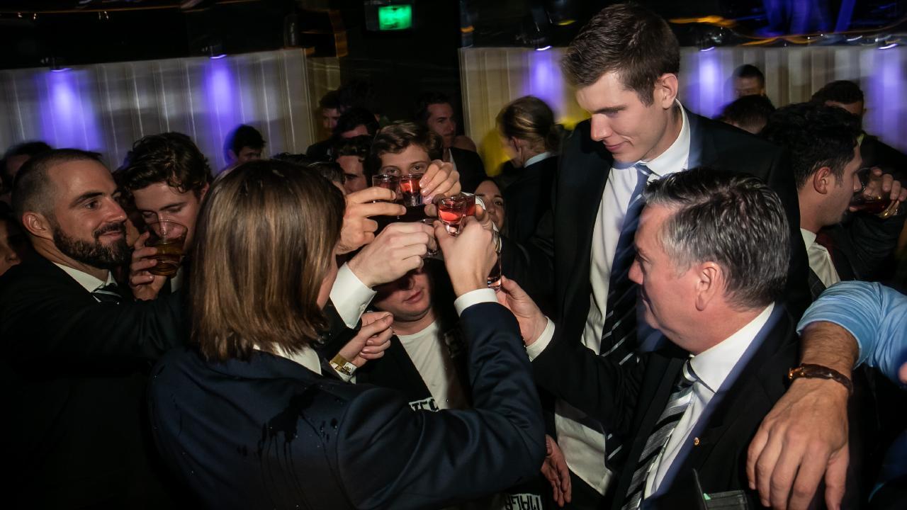 Steele Sidebottom, Mason Cox and Eddie McGuire share a drink at Bond Bar.