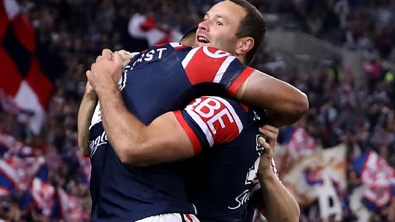 SYDNEY, NEW SOUTH WALES - SEPTEMBER 30: Boyd Cordner of the Roosters celebrates with try-scorer Daniel Tupou of the Roosters during the 2018 NRL Grand Final match between the Melbourne Storm and the Sydney Roosters at ANZ Stadium on September 30, 2018 in Sydney, Australia. (Photo by Mark Kolbe/Getty Images)