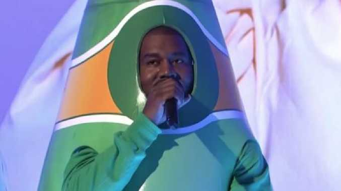 Kanye West dressed as a human-sized bottle of Perrier during his performance of 'I Love It' on SNL. Picture: SNL/Supplied