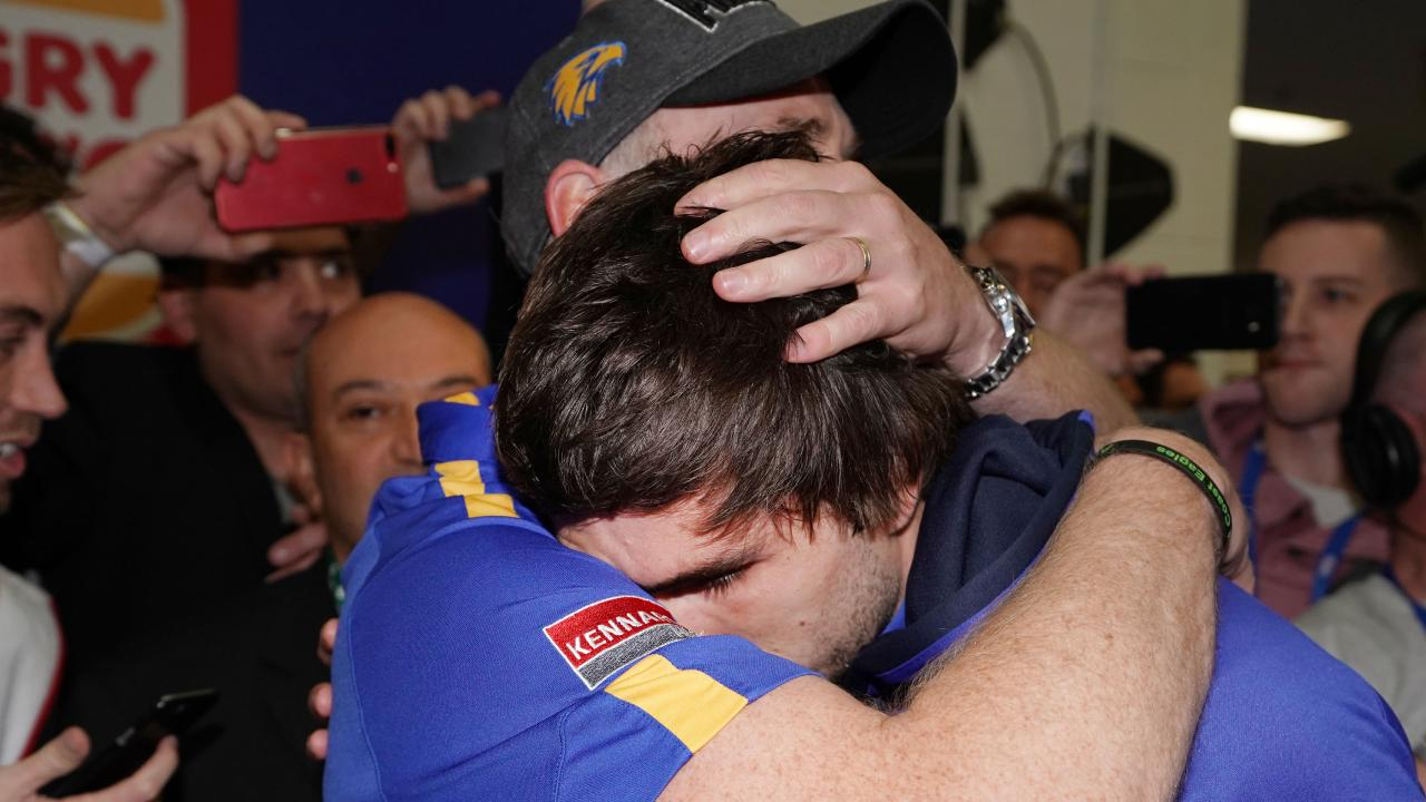 A victorious Eagles head coach Adam Simpson consoles the suspended Andrew Gaff. (Photo by Michael Dodge/AFL Media/Getty Images)
