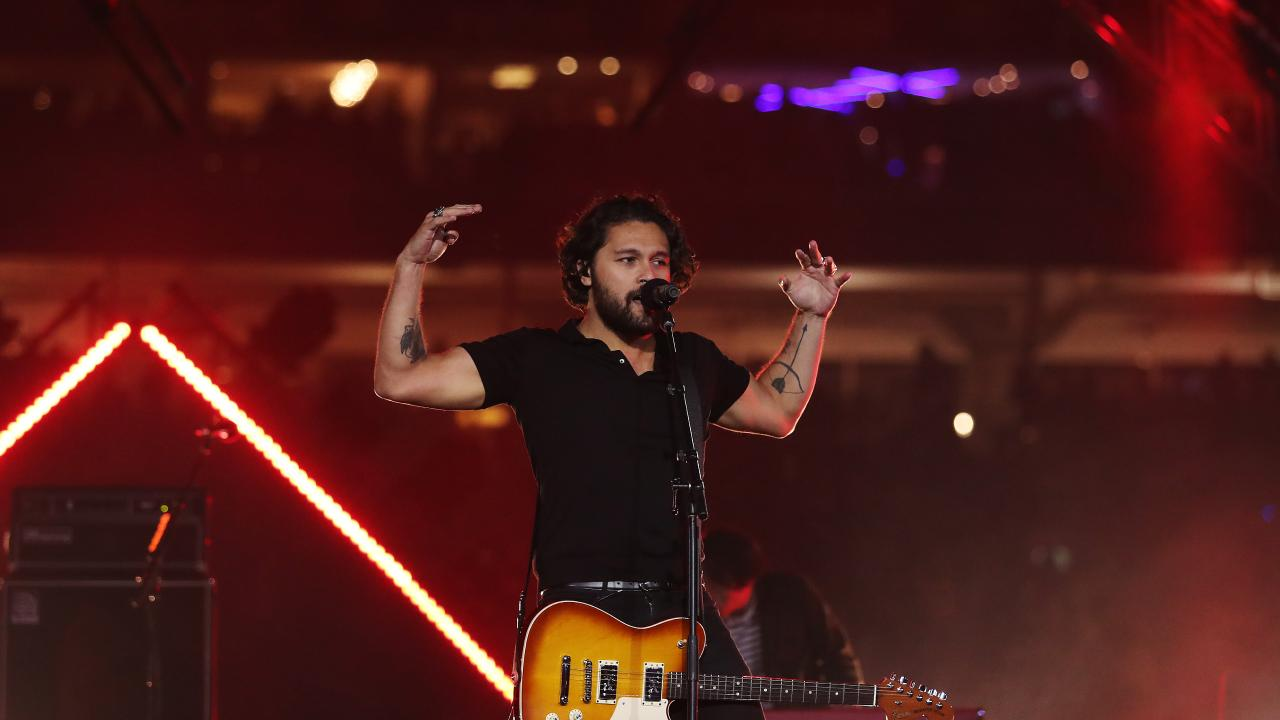 Gang Of Youths perform before the 2018 NRL Grand Final between the Sydney Roosters and Melbourne Storm at ANZ Stadium, Sydney. Picture: Brett Costello