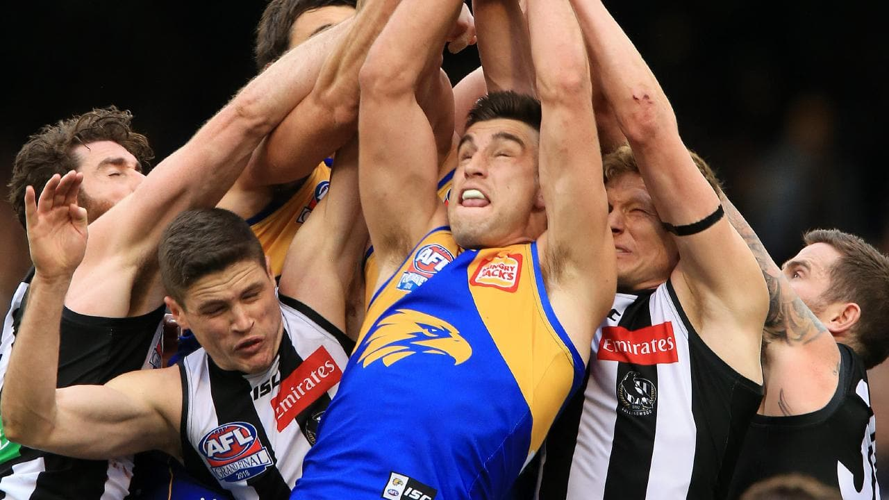 Elliot Yeo flies for a mark in a pack of Magpies. Picture: Mark Stewart