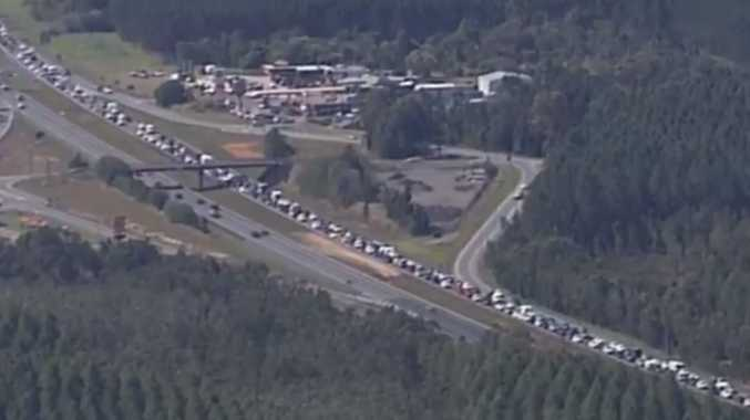 Delays continue on the Bruce Hwy with warning about rouge horses and cattle still in place.