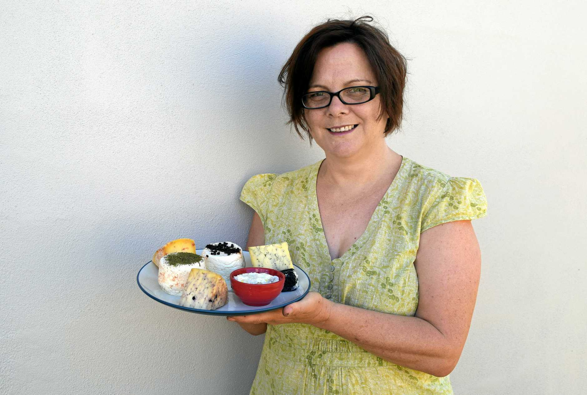 SAY CHEESE: Queensland Cheese Artisan owner Sue Sinclair with a plate of handmade cheese including Tasmanian pepperberry cheddar, ash fresh lactic cheese and wattle seeds fresh cheese.