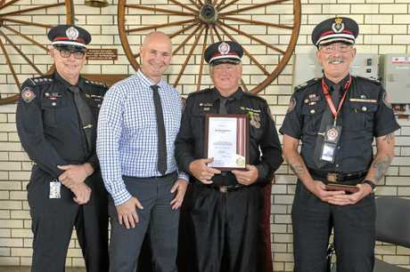 RECOGNITION: Acting Inspector Noel King, State Member for Gladstone Glenn Butcher and Assistant Commisioner for the Central Region Queensland Steve Barber with Captain Donald Baldwin. INSET: Inspector Wayne Larkin accepts his certificate.