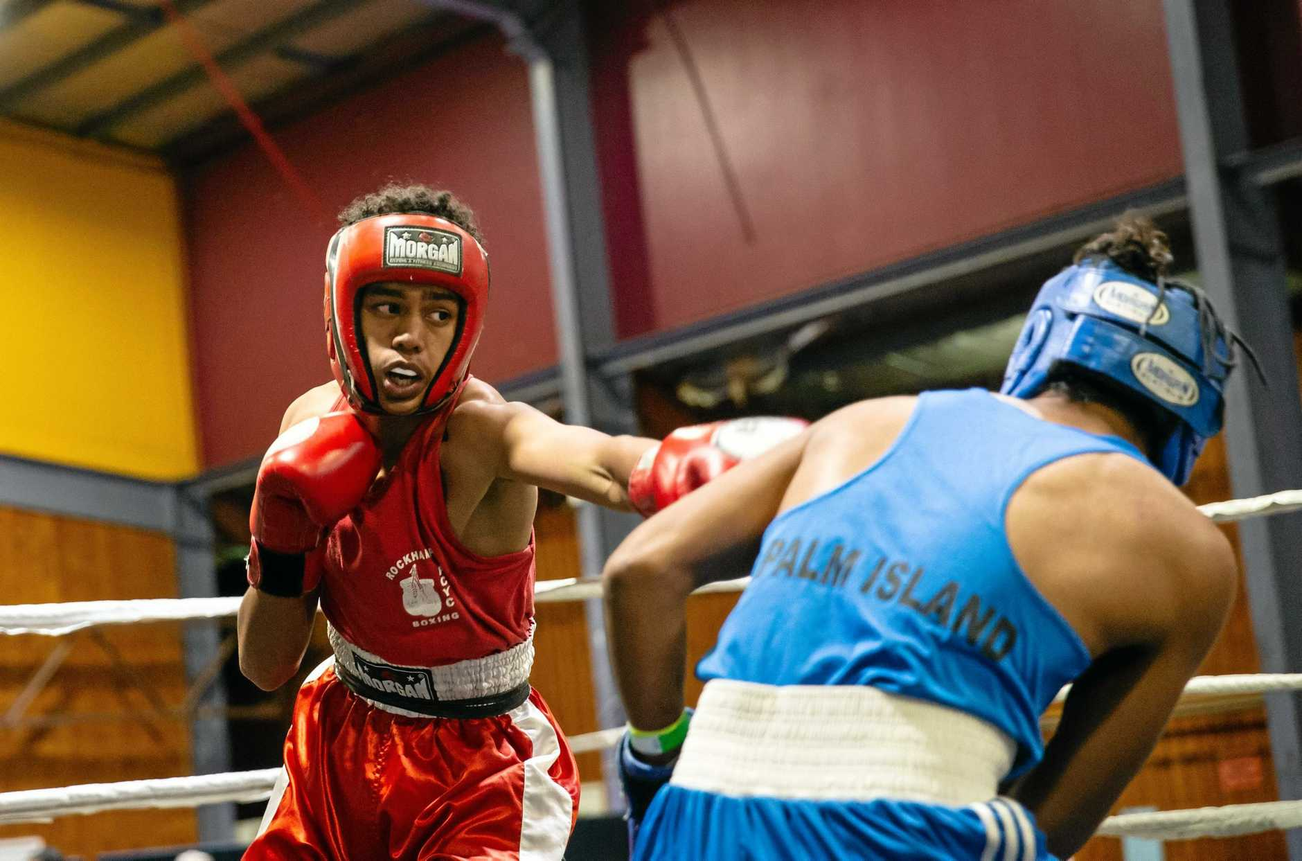 Boxing: PCYC's Drayden Marou (red) and Palm Island's Raymond Haines (blue).