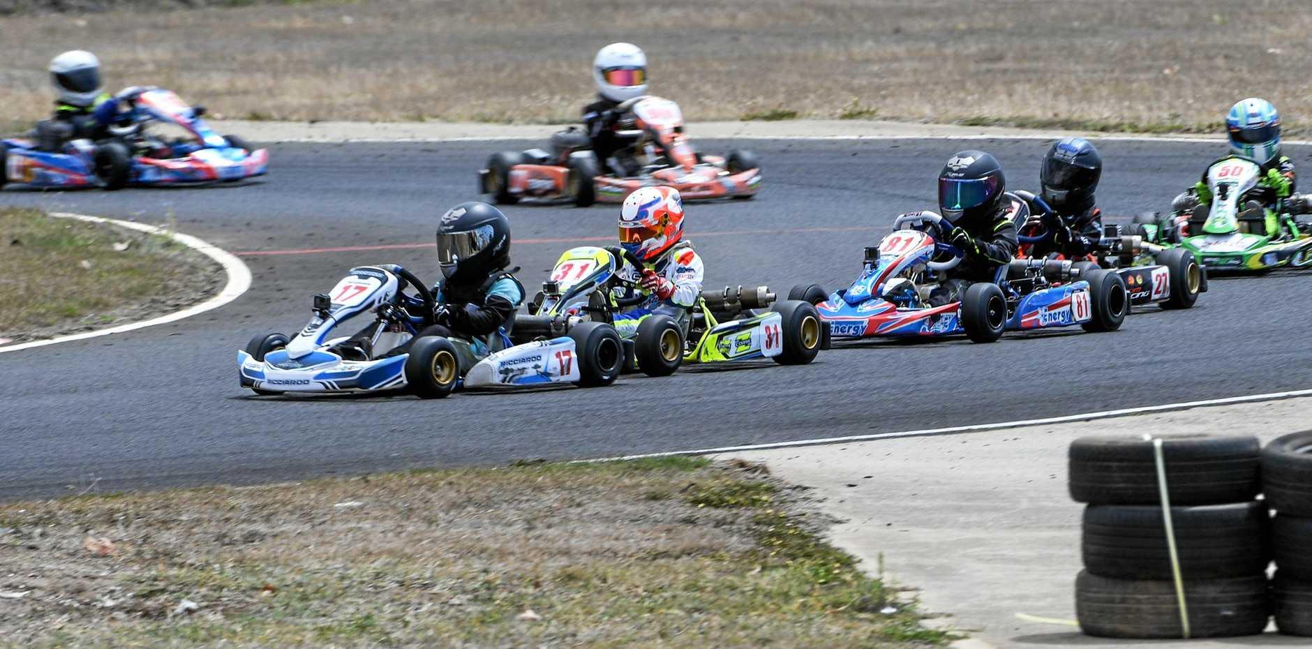 Max Acquasanta leads a pack in close racing in the Cadet 9 class.