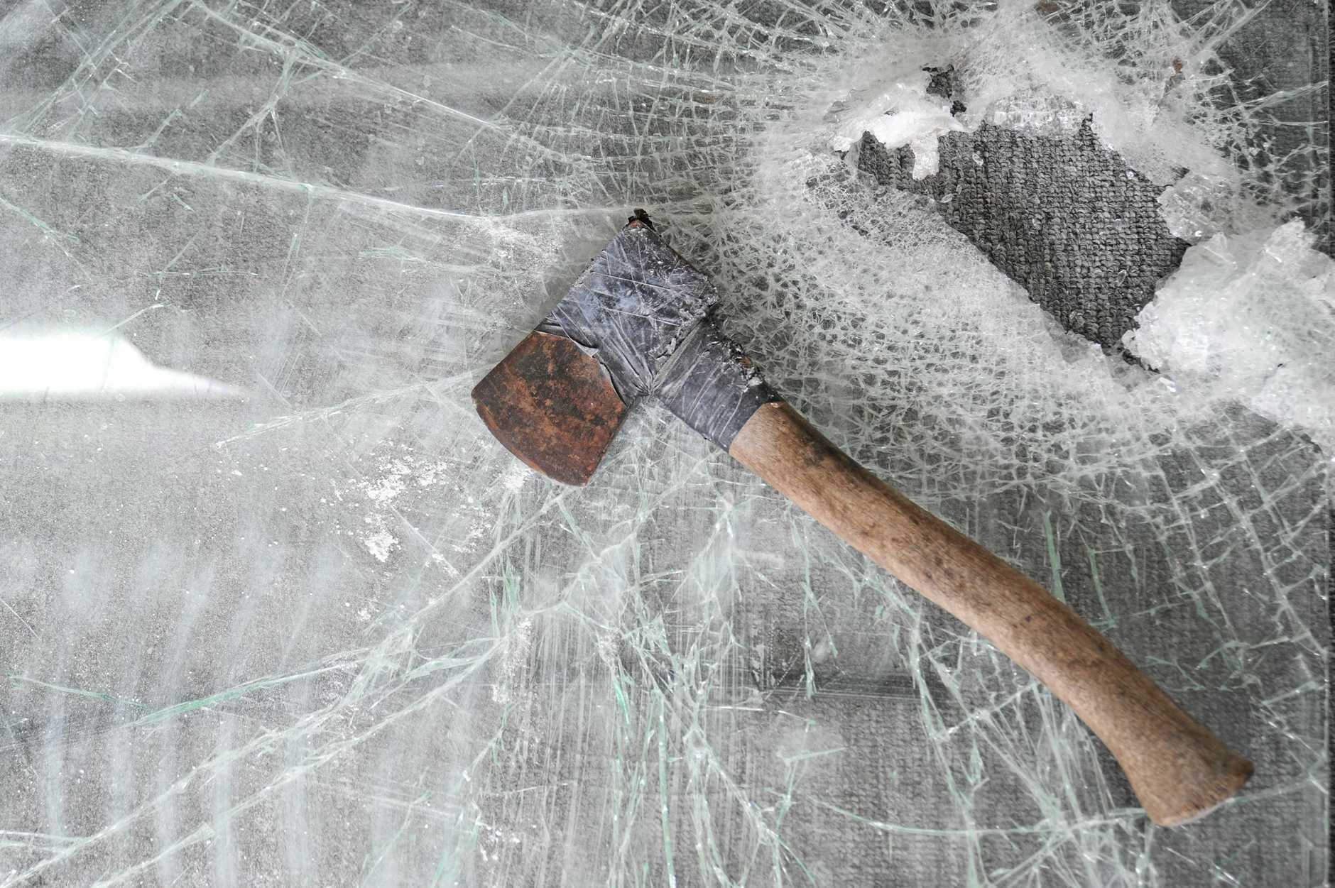 A tomahawk was used to rob a Sunshine Coast cafe overnight.