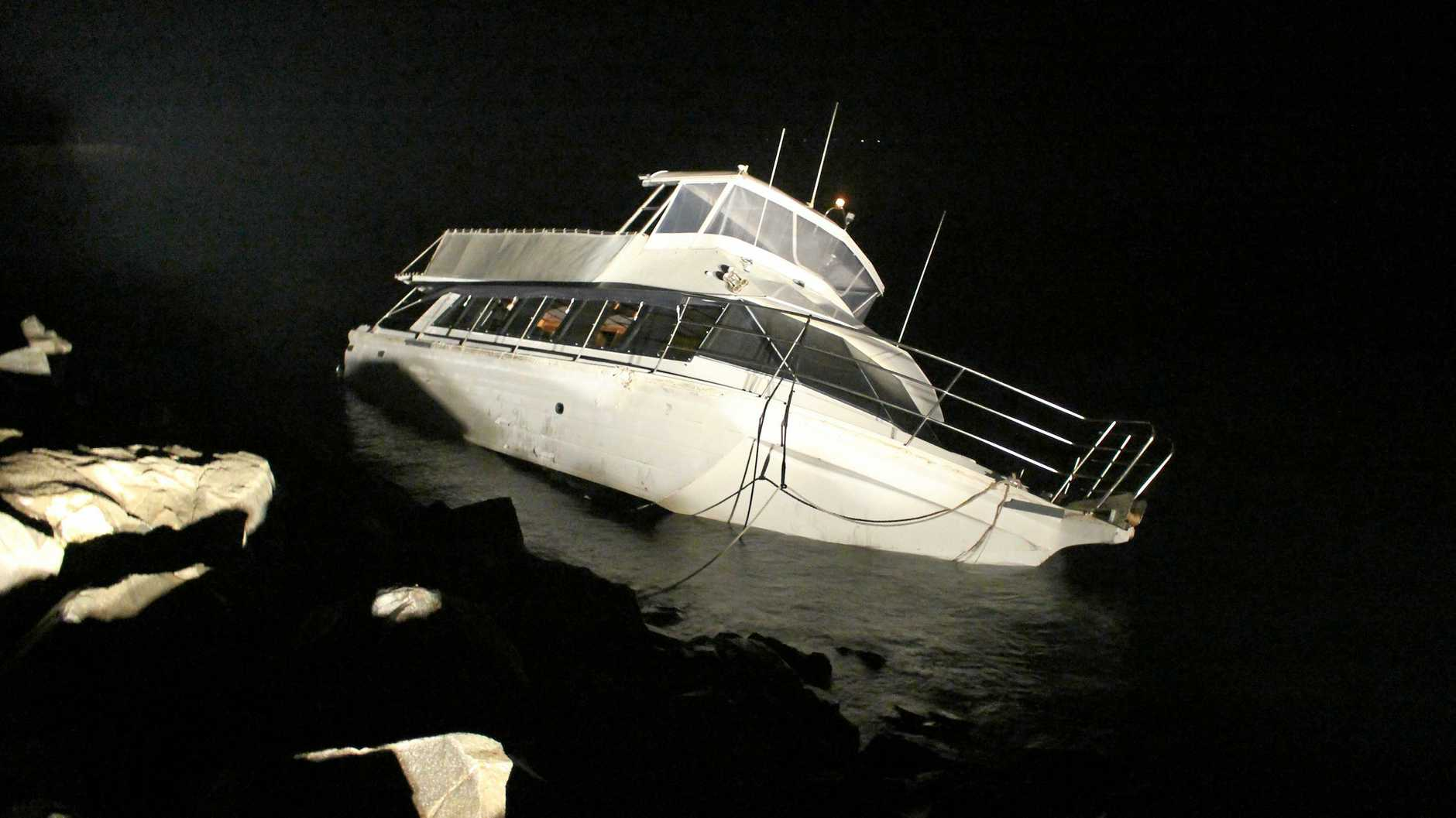 One of two boats who crashed yesterday on the Urangan Rockwall about 1pm.