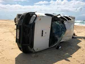 HOLIDAY MISADVENTURES: Cars flip on Fraser Island