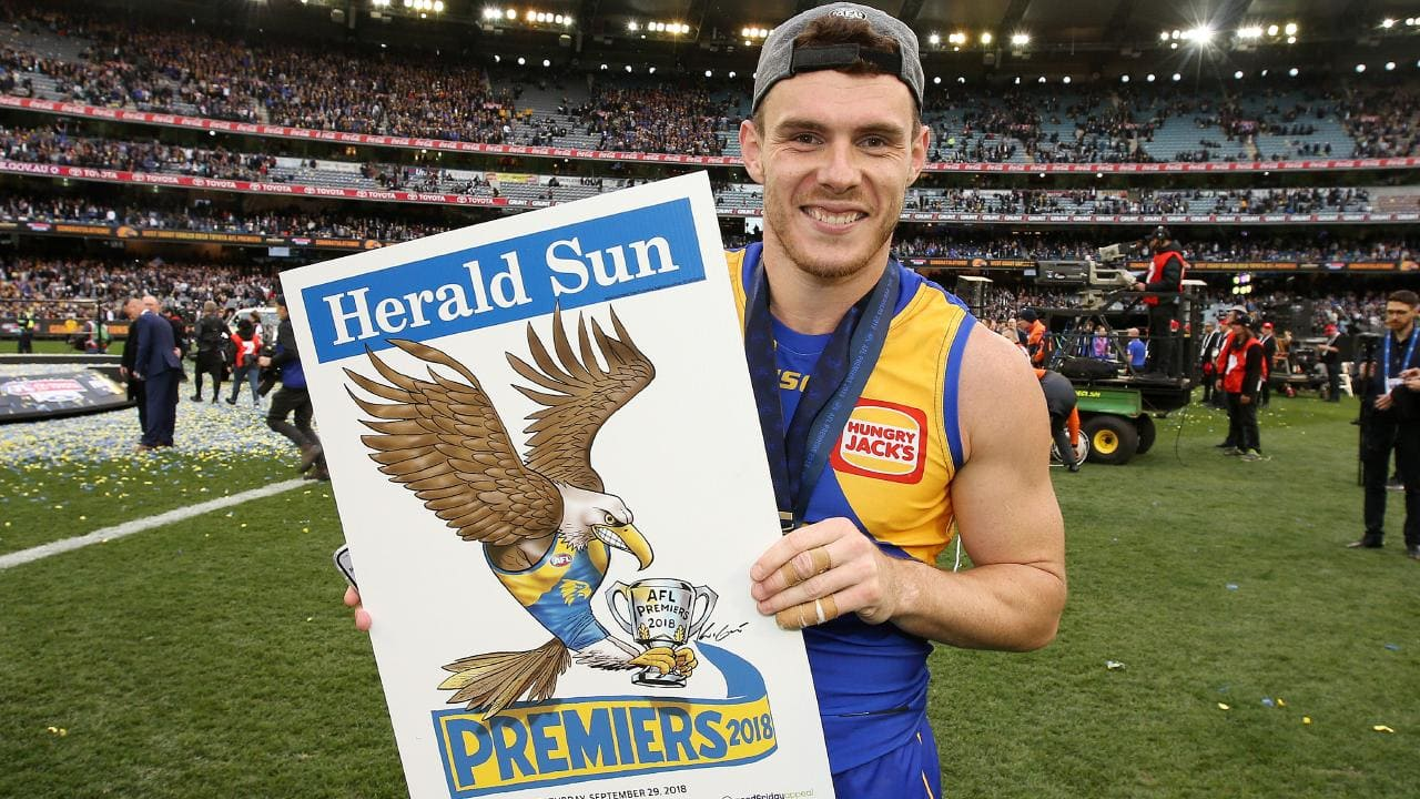West Coast's Luke Shuey with the Herald Sun premiership poster. Pic: Michael Klein