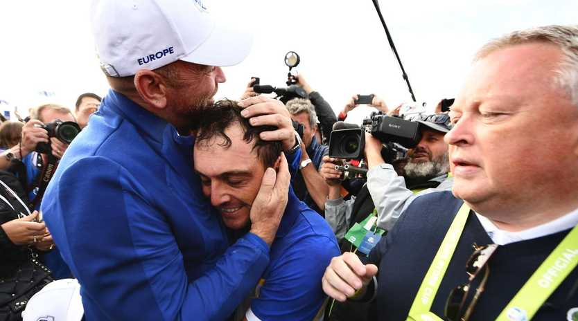 Francesco Molinari (C) celebrates with captain Thomas Bjorn after Europe's Ryder Cup victory. Picture: AFP