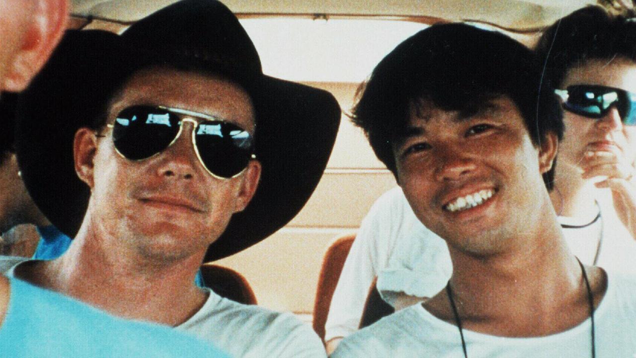 Brendon James Abbott (left) posing as a tourist in 1990.